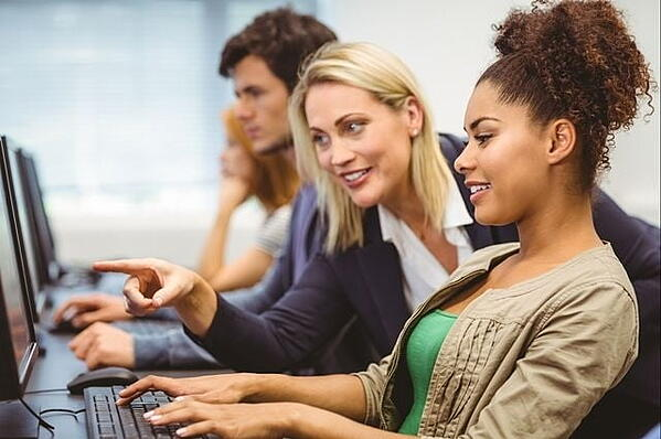 marketing professor showing college student SEO on her computer screen