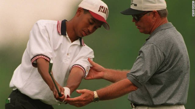 Tiger Woods with Butch Harmon Stanford - personal branding strategy of working with a mentor